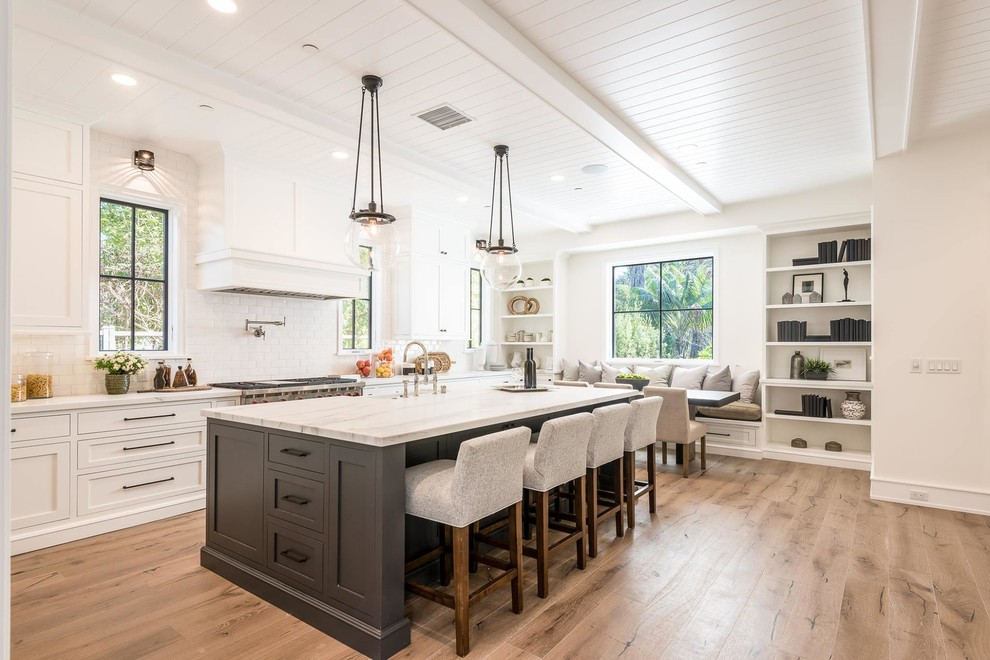 transitional kitchen style with open layout and white interior and kitchen island