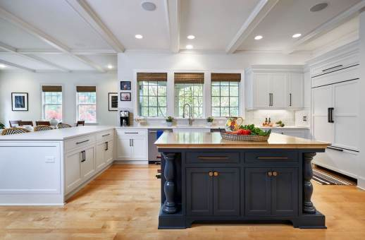 stunning transitional open concept kitchen with navy island and white cabinets