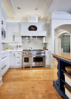 traditional kitchen remodel with range hood and modern features and finishes