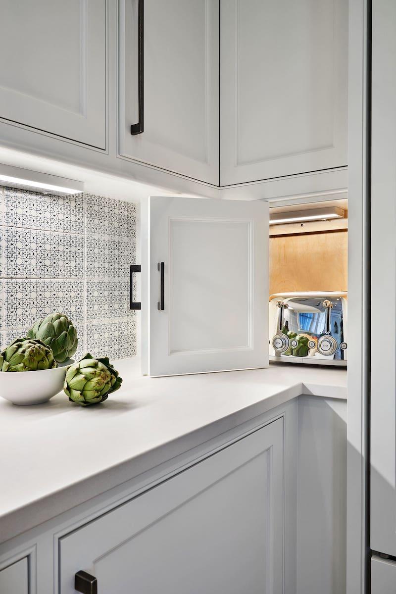 white cabinet with beautiful tile backsplash