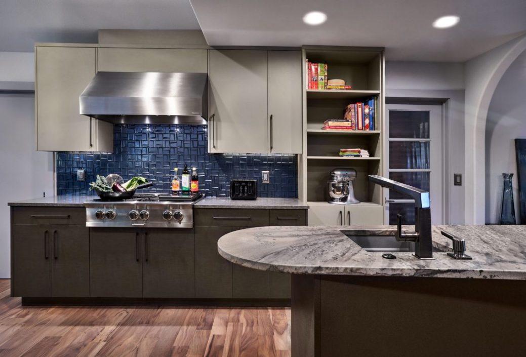 kitchen with hardwood floor, white cabinets, and blue backsplash