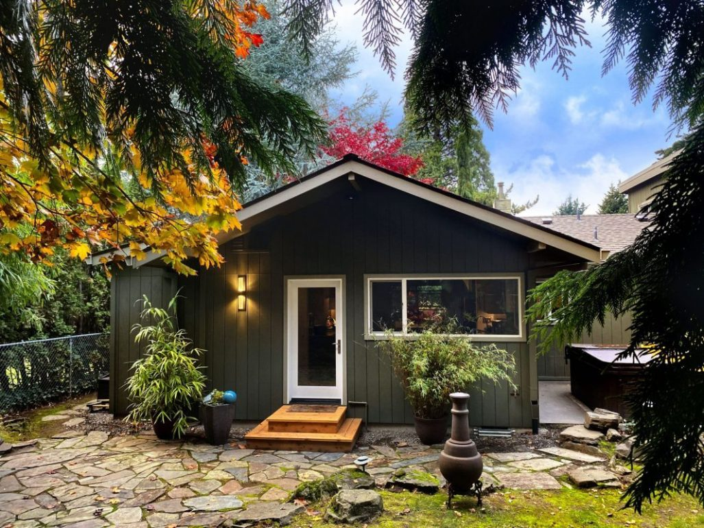 green home in portland with lots of autumnal leaves