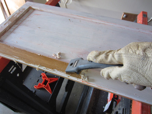 Preparing Kitchen Cabinets For Painting By Sing Off Existing Paint And Varnish