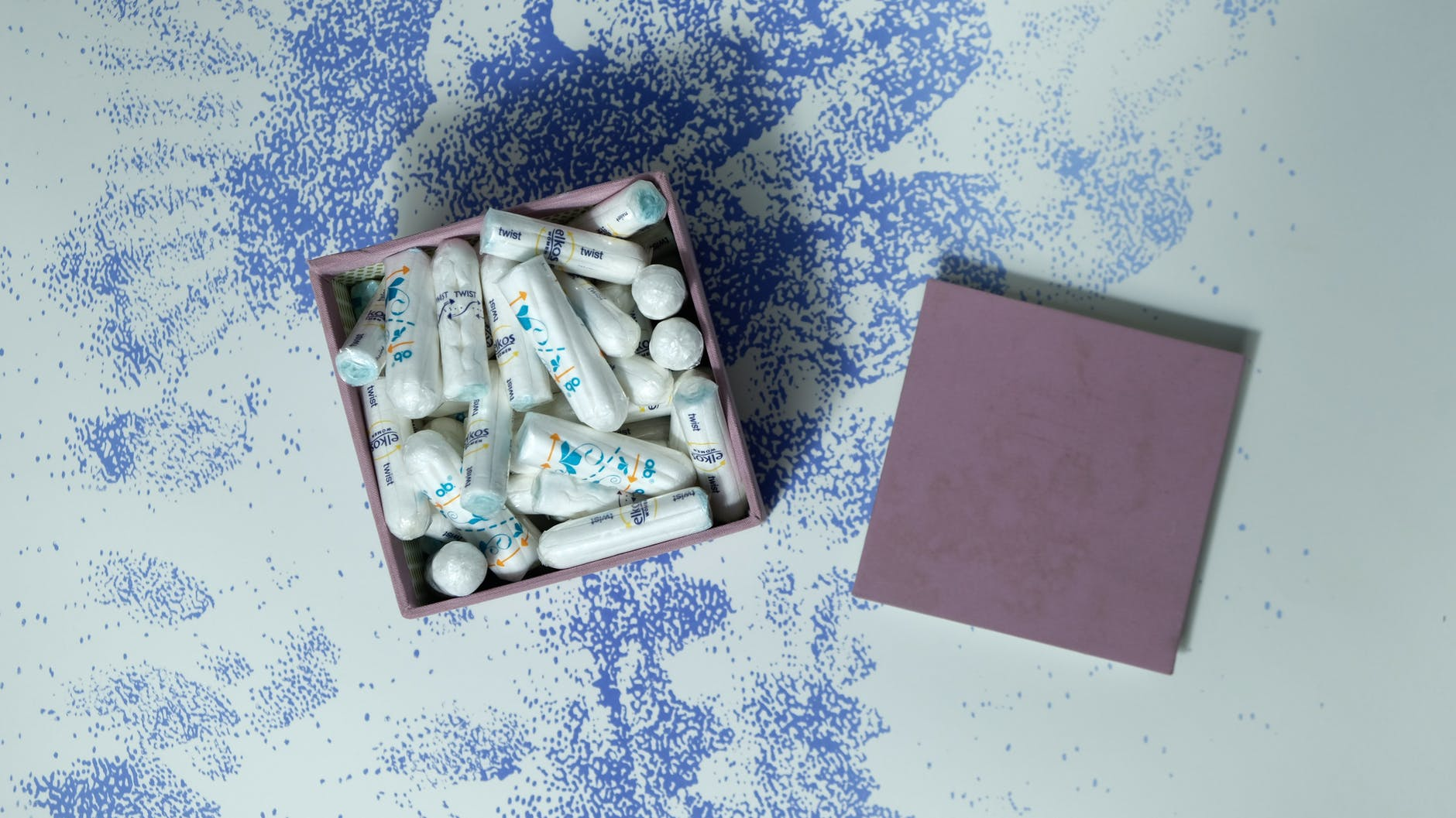 box with heap of tampons