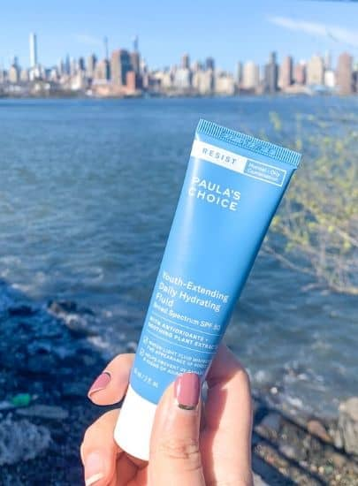 Paula's Choice Youth Extending Hydrating Fluid with a New York City Skyline. Chemical sunscreen with hydrating SPF moisturizer.