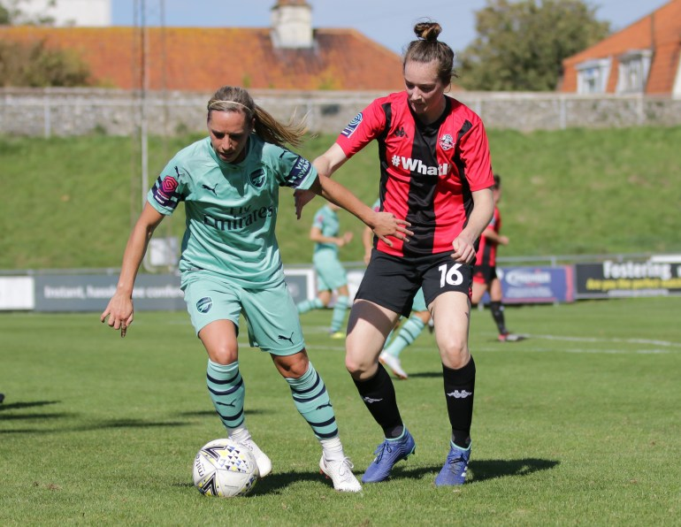 Jordan Nobbs and Sammy Qualyle battle for the ball pic James Boyes-1