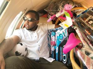 CEO of LPMG, Lex Pierre-Louis, on his way to Haiti with toys in tow.