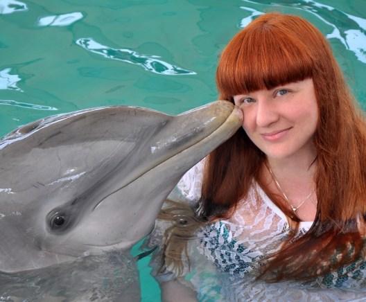 Dolphin Kissing Lezli Robyn—Sail to Success Norwegian Sky Cruise (Paradise Lagoon, Bahamas)