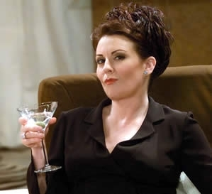 Karen Walker - Grace's assistant, she frequently implies that she's attracted to other women, and claims Martina Navratilova came out because of her.