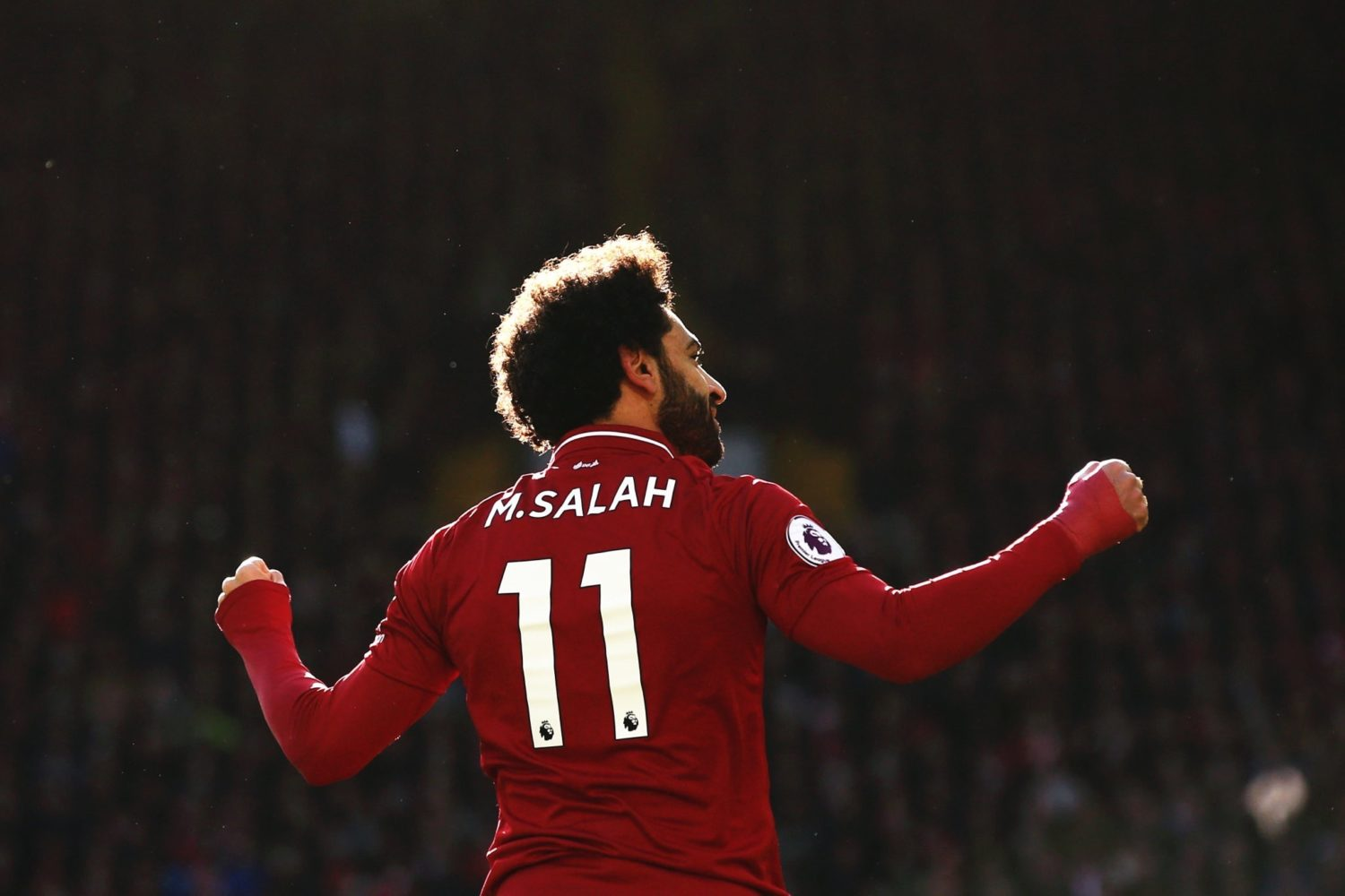 Shaqiri and Salah fire Liverpool past Fulham and into first