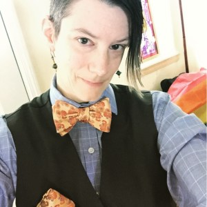 Author photo of Anna Zabo looking very dapper in a bowtie.