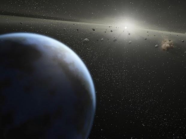Concepção artística divulgada pela Nasa mostra cinturão massivo de asteroides viajando ao redor de uma