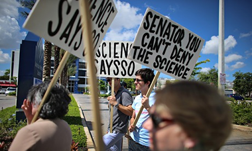 Protesters gather near the office of Senator Marco Rubio to ask him to take action to address climate change. Photo: Joe Raedle / Getty Images
