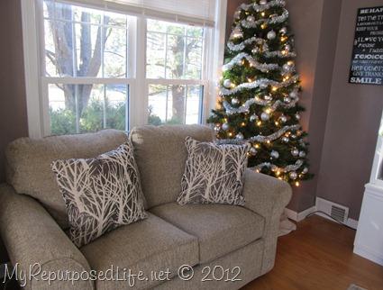 crowded living room corner Christmas tree