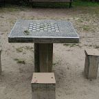 A checkers table in a community park.