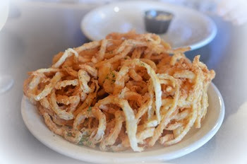 something extra tasty about these onion rings and spicy tartar sauce