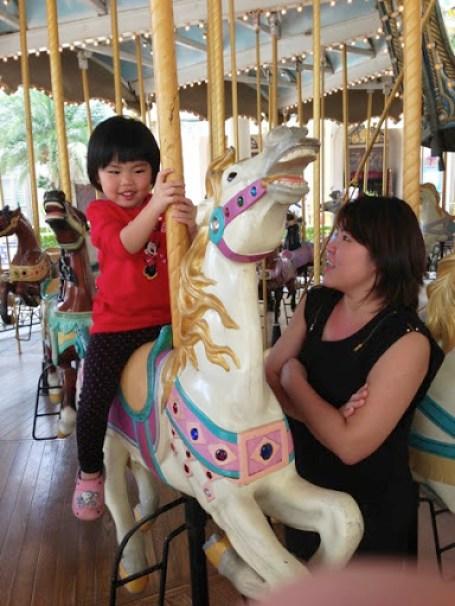 Yining On The Carousel