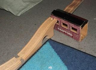 How We Homeschool, Part 1 Unit Studies Trains, yellowreadis.com Image: Wooden toy train tracks on blue carpet