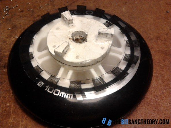 two plastic pieces, wheel and encoder wheel glued