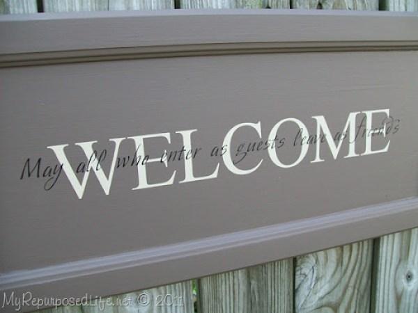 closeup cupboard door sign | Welcome