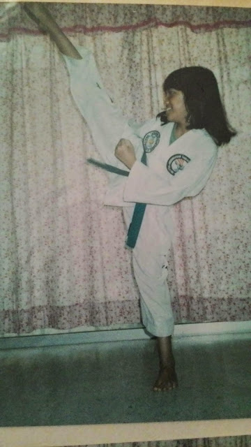 Girl practicing Taekwondo