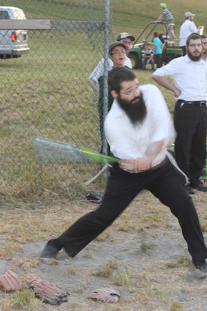 Head Counselor Shimon Gorkin takes a swing