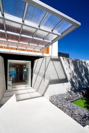 fachadas-de-casa-con-hormigon-madera-y-aluminio