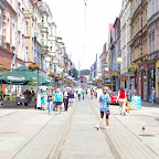 There is a tramway line in the middle of the pedestrian area.