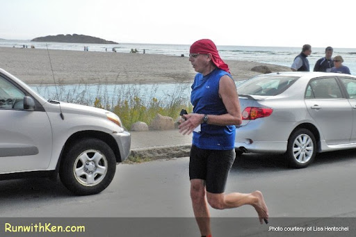 "Ken Skier (""the Running Photographer"") Running barefoot at the 2010 Lone Gull 10K in Gloucester, MA"
