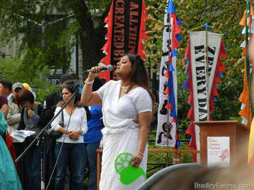 A woman singing at the Lotus Lantern Festival, Union Square, 2011.