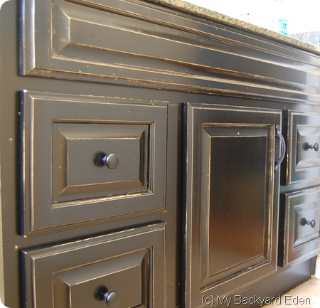 Wow! Looks so good! Stain your bathroom vanity cabinet with gel stain. Such an easy DIY project. No stripping required!