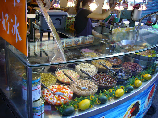 toppings for shaved ice and lemon aiyu on the right