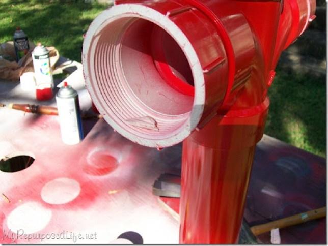 red pvc fire hydrant yard art