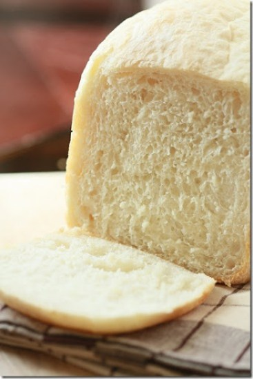 A loaf of bread made from a bread maker recipe sliced into.
