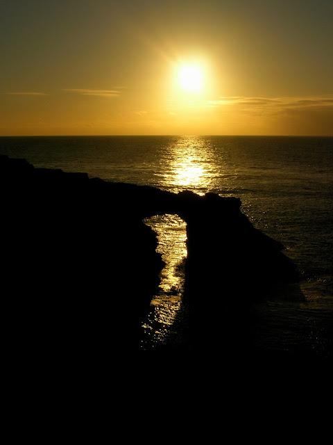 Evening light through the sea arch