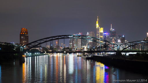 "Skyline of Frankfurt City at night I shot the image while staying on the new bridge in Frankfurt named ""Osthafenbrücke"". The large house at left side of the picture is one of designed and built by a very famous Austrian architecture F.Hundertwasser."