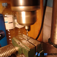 lowerinig_threaded_rod_onto_drill_bit.jpg