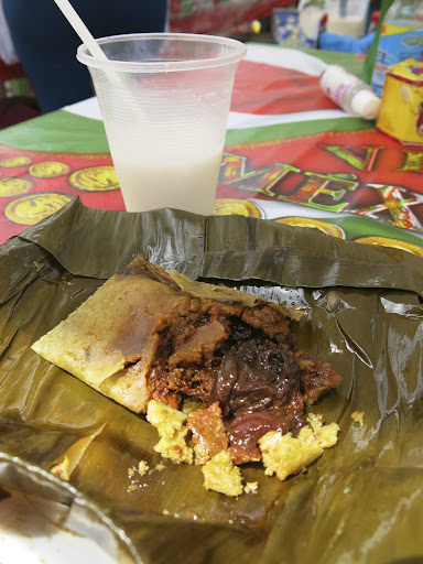 Tamale de mole and horchata drink. I've never tasted (real) good mole until I've been in Mexico.