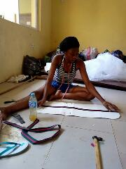 Nigerian Lady Precious Olayide Makes Her Money By Producing Bags,Sandals & Slippers(Photos)