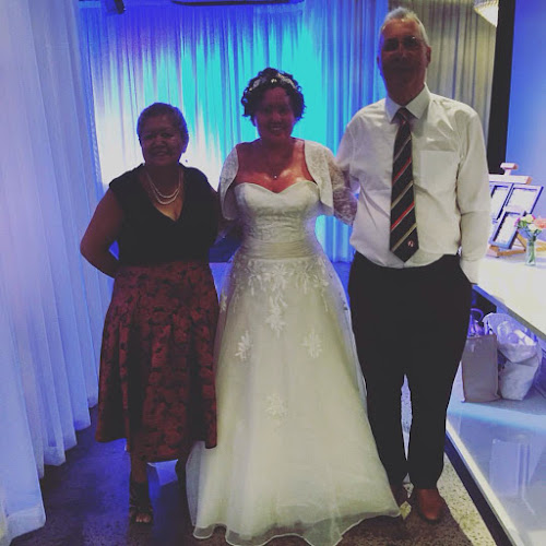 Carly findlay and parents on wedding day