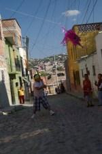 Diego chasing piniata.