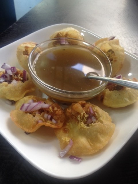 Gol guppa, known as pani puri, served at Indigo in Rich Mix