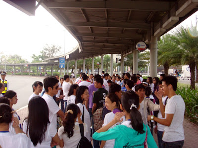 Students wait at the SM Mall of Asia Grounds.