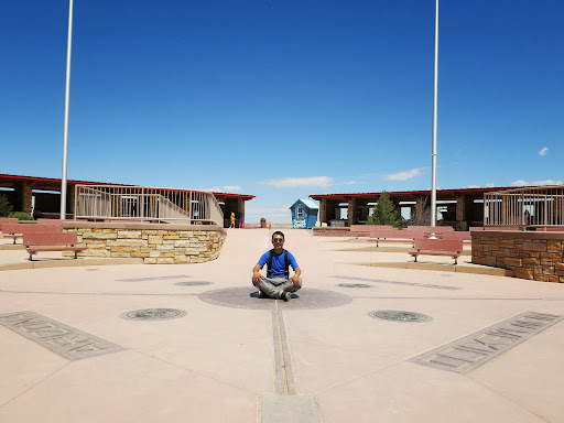 Sitting on the Four Corners, the exact spot that marks the separation between Utah, Colorado, New Mexico and Arizona. It was super hot (36C)