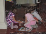 Nadia and their friends playing on the floor.