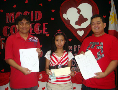 Sir Jojo presents P2,000 cash prize to Jennyfer Cahilig for winning the MCCID FSL Design Font Contest.