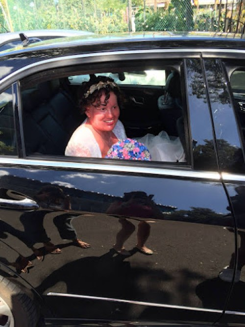 Carly findlay in car on wedding day