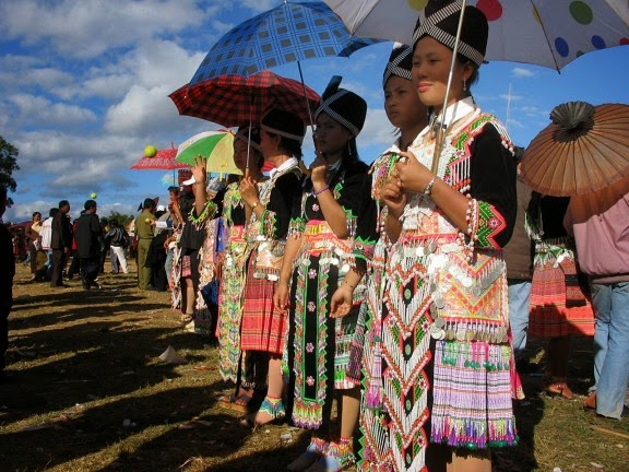 Hmong girls meet possible suitors while playing a ball-throwing game in Laos.