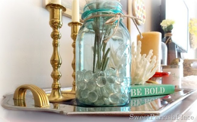 A Thrifted silver tray gets a refresh with a little gold leaf metallic spray paint.