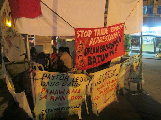 Banners hung around the site where 17 members of the RMN Davao Employees Union organised a 41-day strike, outside their station in Davao city, in protest against an alleged failure by the management to honor terms under their collective agreement.